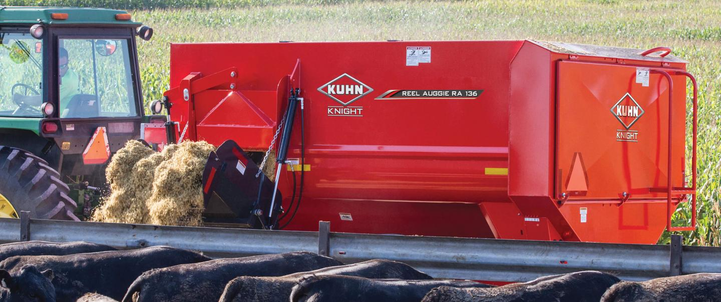 In the foreground you can see a RA 136 mixer delivering feed to a feedlot of cattle.
